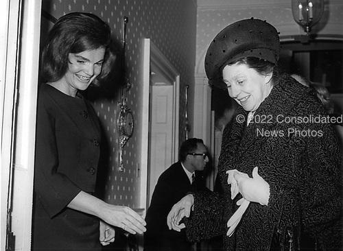 Former first lady Jacqueline Bouvier Kennedy, left, welcomes Laura Carta Camprino, wife of President Antonio Segni of Italy, right, to her Georgetown home in Washington, DC on January 14, 1964.  Mrs. Segni had tea with the former first lady for a half hour while her husband met with United States President Lyndon B. Johnson at the White House.<br /> Credit: Benjamin E. &quot;Gene&quot; Forte / CNP