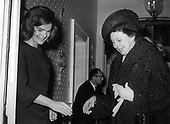"Former first lady Jacqueline Bouvier Kennedy, left, welcomes Laura Carta Camprino, wife of President Antonio Segni of Italy, right, to her Georgetown home in Washington, DC on January 14, 1964.  Mrs. Segni had tea with the former first lady for a half hour while her husband met with United States President Lyndon B. Johnson at the White House.<br /> Credit: Benjamin E. ""Gene"" Forte / CNP"
