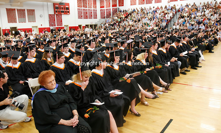 SOUTHBURY, CT 06/25/09- 062509BZ05- Watertown High School graduates listen during commencement excercises held inside the Pomperaug High School gym because of construction at Watertown High.<br /> Jamison C. Bazinet Republican-American