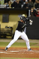 UCF Knights infielder James Vasquez (13) at bat during the opening game of the season against the Siena Saints on February 13, 2015 at Jay Bergman Field in Orlando, Florida.  UCF defeated Siena 4-1.  (Mike Janes/Four Seam Images)