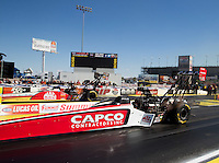 Mar 30, 2014; Las Vegas, NV, USA; NHRA top fuel driver Steve Torrence (near lane) races alongside Doug Kalitta during the Summitracing.com Nationals at The Strip at Las Vegas Motor Speedway. Mandatory Credit: Mark J. Rebilas-