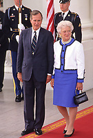 United States President George H.W. Bush, left, and first lady Barbara Bush, right, watch as President Mikhail Gorbachev of the Union of Soviet Socialist Republics and his wife, Raisa, depart on the North Portico of the White House in Washington, DC on Sunday, June 3, 1990.  The Gorbachevs were in Washington for a three day summit that included visits to Wellesley, Massachusetts and Camp David, the presidential retreat near Thurmont, Maryland.<br /> CAP/MPI/RS<br /> &copy;RS/MPI/Capital Pictures