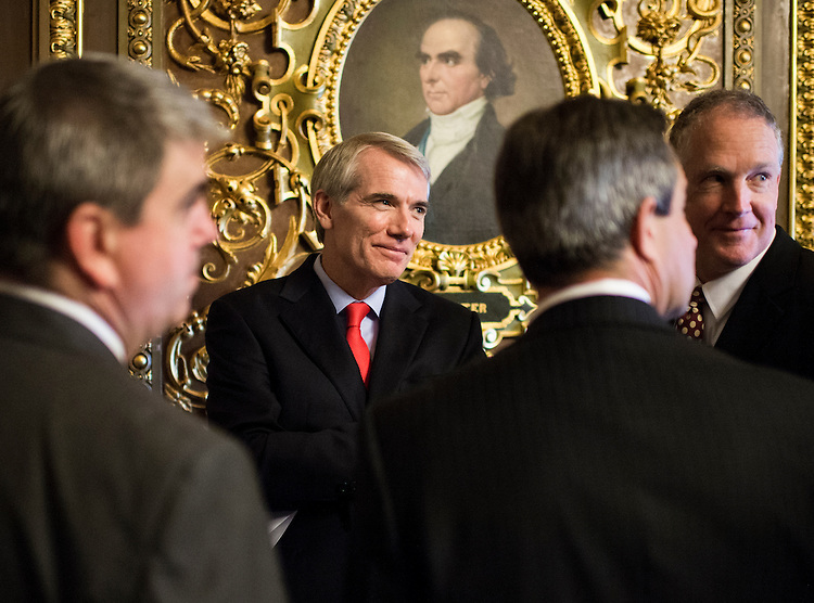UNITED STATES - JULY 18: Sen. Rob Portman, R-Ohio, speaks with reporters in the Senate Reception Room before the start of the policy luncheons on Thursday, July 18,  2013. (Photo By Bill Clark/CQ Roll Call)
