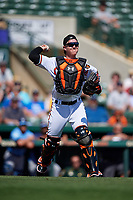 Baltimore Orioles catcher Chance Sisco (15) throws to first base during a Grapefruit League Spring Training game against the Tampa Bay Rays on March 1, 2019 at Ed Smith Stadium in Sarasota, Florida.  Rays defeated the Orioles 10-5.  (Mike Janes/Four Seam Images)