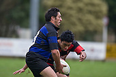Nick Farrell looks to offload as he is about to be tackled by J. Tamalii. Counties Manukau Division 2 Rugby game between Onewhero & Papakura played up on the hill at Onewhero on Saturday June 28th 2008..Papakura won 25 - 13 after Onewhero led 10 - 8 at halftime.