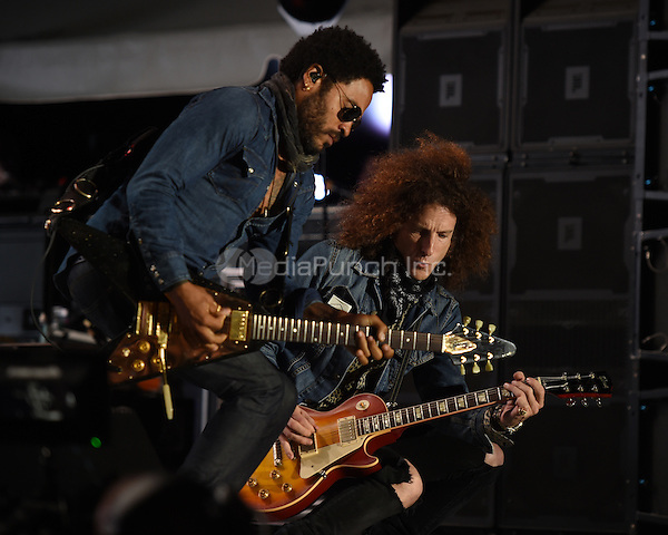 WEST PALM BEACH - APRIL 29: Lenny Kravitz and Craig Ross perform during Sunfest on April 29, 2015 in West Palm Beach, Florida. Credit: mpi04/MediaPunch