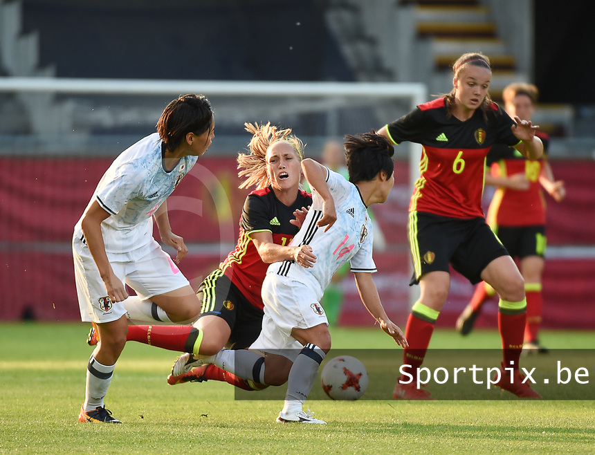 20170613 - LEUVEN ,  BELGIUM : Belgian Tine De Caigny (R) and Janice Cayman (M) with Japanese Saki Kumagai (L) and Yu Nakasato (14) pictured during the female soccer game between the Belgian Red Flames and Japan , a friendly game before the European Championship in The Netherlands 2017  , Tuesday 13 th Juin 2017 at Stadion Den Dreef  in Leuven , Belgium. PHOTO SPORTPIX.BE | DIRK VUYLSTEKE