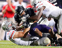 Ohio State Buckeyes defensive lineman Joey Bosa (97) brings down Northwestern Wildcats running back Venric Mark (5) with help from Ohio State Buckeyes defensive lineman Noah Spence (8) the second half of Saturday's NCAA Division I football game at Ryan Field in Evanston on October 5 2013. (Barbara J. Perenic/The Columbus Dispatch)