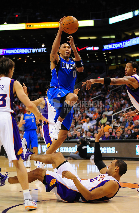 Mar. 27, 2011; Phoenix, AZ, USA; Dallas Mavericks forward (0) Shawn Marion drives to the basket above Phoenix Suns forward (33) Grant Hill in the first quarter at the US Airways Center. Mandatory Credit: Mark J. Rebilas-