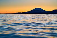 Sunset behind mount Edgecumbe, an inactive volcano on Kruzof Island, southeast Alaska.