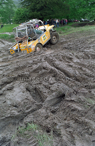 Yellow Land Rover Series 1 based off-road racer struggling with mud at the 1993 National Rally. The Association of Rover Clubs (A.R.C., since 2006 the Association of Land Rover Clubs ALRC) National Rally is the biggest annual motor sport oriented Land Rover event and was hosted 1993 by the Midland Rover Owners Club at Eastnor Castle in Herefordshire. --- No releases available. Automotive trademarks are the property of the trademark holder, authorization may be needed for some uses.