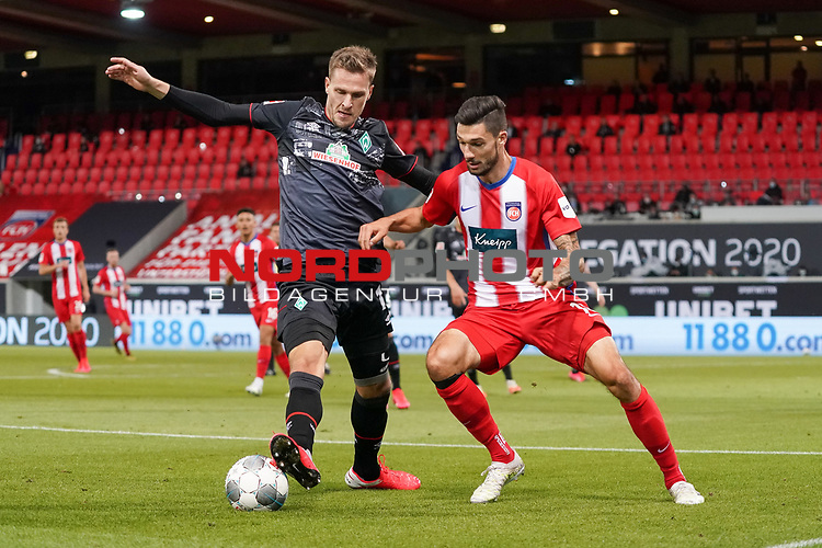 Sebastian Langkamp (Werder Bremen #15), Jonas David Otto (1. FC Heidenheim 1846 #26)<br /> <br /> <br /> Sport: nphgm001: Fussball: 1. Bundesliga: Saison 19/20: Relegation 02; 1.FC Heidenheim vs SV Werder Bremen - 06.07.2020<br /> <br /> Foto: gumzmedia/nordphoto/POOL <br /> <br /> DFL regulations prohibit any use of photographs as image sequences and/or quasi-video.<br /> EDITORIAL USE ONLY<br /> National and international News-Agencies OUT.