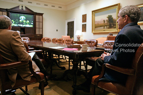 Washington, D.C. - October 28, 2006 -- In a video teleconference between the White House and Baghdad, United States President George W. Bush talks with Prime Minister Nouri al-Maliki of Iraq on Saturday, October 28, 2006. .Credit: Kimberlee Hewitt-White House via CNP.