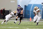 SIOUX FALLS, SD, OCTOBER 8:  Josh Angulo #8 from the University of Sioux Falls gets a step past Gene Germain #57 and Tyler Flud #27 from Southwest Minnesota State University in the first half Saturday night at Bob Young Field. (Photo by Dave Eggen/Inertia)
