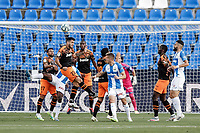 12th July 2020; Estadio Municipal de Butarque, Madrid, Spain; La Liga Football, Club Deportivo Leganes versus Valencia; Maxi Gomez (Valencia CF) clears with a header from the cross