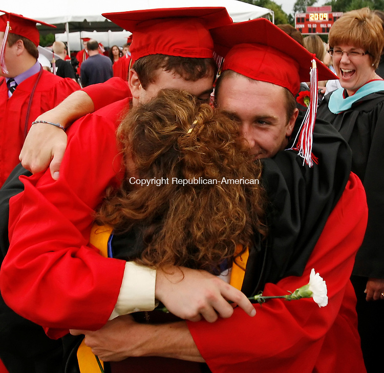 CHESHIRE, CT 06/23/09- 062309BZ12- English teacher Donna Carbone gets hugged by her son Ryan Carbone, left, and his friend Steve Carlette after commencement excercises at Cheshire High School Tuesday evening.<br /> Jamison C. Bazinet Republican-American