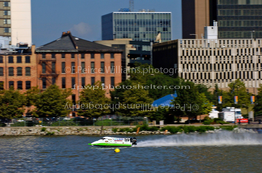 Wyatt Nelson's DAC/Mercury speeds past downtown Toledo.