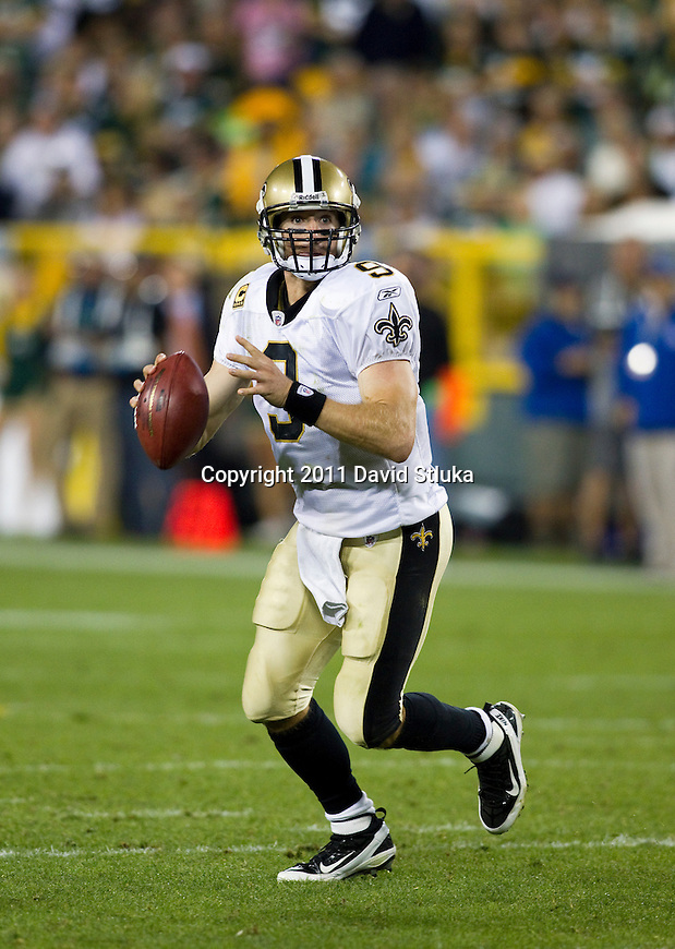 New Orleans Saints quarterback Drew Brees (9) looks for a receiver during a Week 1 NFL football game against the Green Bay Packers on September 9, 2011 in Green Bay, Wisconsin. The Packers won 42-34. (AP Photo/David Stluka)