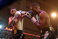 Kay Prospere (R) defeats Bilal Rehman during a Boxing Show at the Dunstable Conference Centre on 7th March 2020