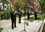 Margaret Philbrick, Dave Inmon, Thomas Stark and Mark Fry perform as members of the DePaul University faculty process towards the St. Vincent de Paul Parish Church Thursday, Aug. 31, 2017, kicking off the 120th school year with the annual Academic Convocation. Marten denBoer, provost, provided remarks, and many faculty and staff were recognized with annual awards as part of the annual celebration. (DePaul University/Jamie Moncrief)