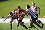 Sherwin Stowers muscles his way out of Mike Pehi's tackle. Air New Zealand Air NZ Cup warm-up rugby game between the Counties Manukau Steelers & Tasman Mako's, played at Growers Stadium Pukekohe on Sunday July 20th 2008..Counties Manukau won the match 30 - 7.