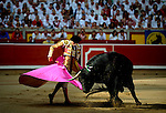 Spanish matador Matias Tejela performs a pass with capote to a El Pilar bull during the fourth corrida of the San Fermin Festival, on July 10, 2012, in the Northern Spanish city of Pamplona. (c) Pedro ARMESTRE