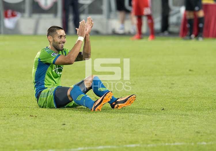 August 10, 2013: Seattle Sounders FC forward Clint Dempsey #2 acknowledges the Toronto FC fans after being taken to the ground and no foul was called during an MLS regular season game between the Seattle Sounders and Toronto FC at BMO Field in Toronto, Ontario Canada.<br /> Seattle Sounders FC won 2-1.