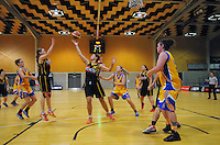 Action from the 2015 Women's Basketball Championship plate match between the Capital Flyers (black and yellow) and Tauranga City Coasters at Te Rauparaha Arena, Porirua, Wellington, New Zealand on Thursday, 4 June 2015. Photo: Dave Lintott / lintottphoto.co.nz