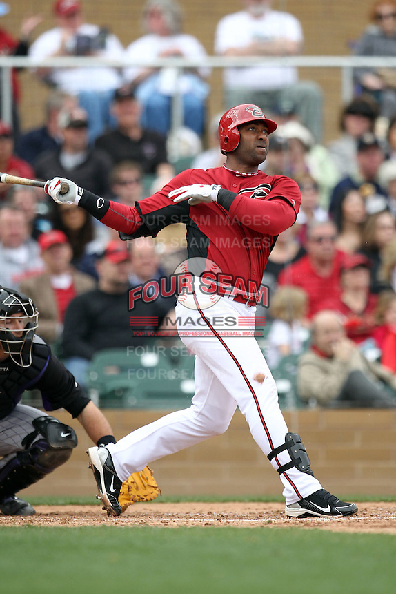 Juan Miranda #46 of the Arizona Diamondbacks plays against the Colorado Rockies in the inaugural spring training game at Salt River Fields on February 26, 2011 in Scottsdale, Arizona. .Photo by:  Bill Mitchell/Four Seam Images.