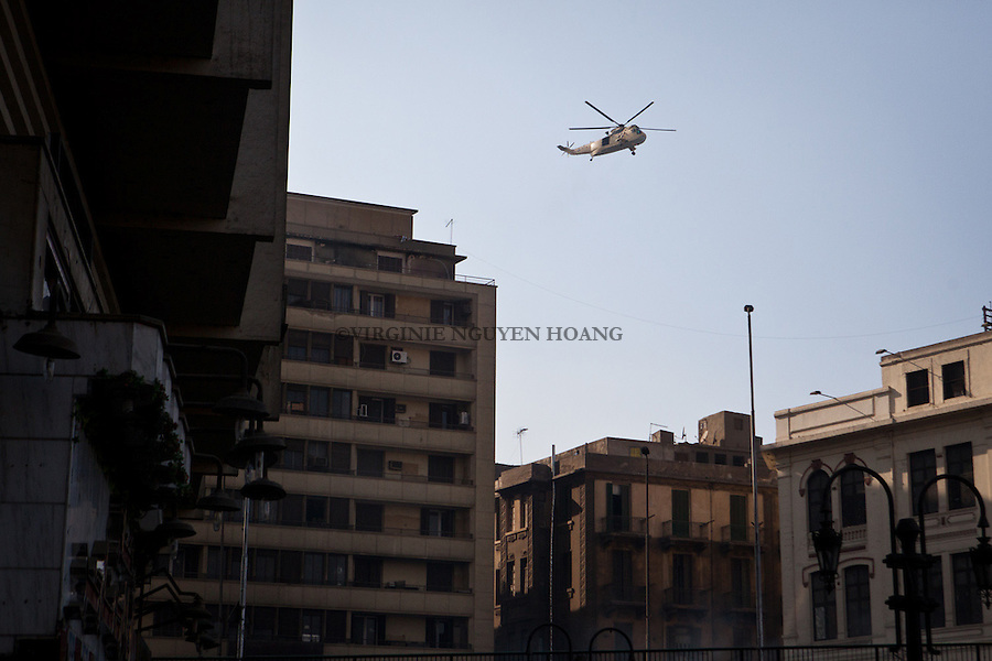 CAIRO - 16 AUGUST: An helicopter from security force is firing on pro Morsi protesters in Ramses Square - Clashes are happening in downtown Cairo as violence erupts in the city after Mohamed Morsi supporters called for &ldquo;Friday of Rage&rdquo; marches to protest the recent deadly police crackdown on their sit-ins. <br /> According to the Health Ministry the current number of dead civilians in today&rsquo;s violence is 17, and 104 people have been injured nationwide.