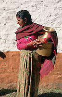 Part of a woman's daily routine in Jalbire, a small village in central northern Nepal, is to fetch water from the torrential mountain stream below the village and carry it up the hill. For some women, this means a daily climb of several thousand feet.