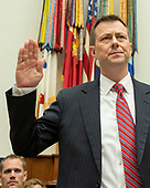 "FBI Deputy Assistant Director Peter Strzok is sworn-in to testify during a joint hearing of the United States House Committee on the Judiciary and the US House Committee on Oversight and Government Reform on ""Oversight of FBI and DOJ Actions Surrounding the 2016 Election"" on Capitol Hill in Washington, DC on Thursday, July 12, 2018. <br /> Credit: Ron Sachs / CNP<br /> (RESTRICTION: NO New York or New Jersey Newspapers or newspapers within a 75 mile radius of New York City)"