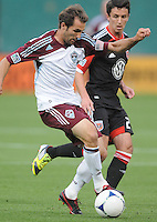 Colorado Rapids midfielder Brian Mullan (11) shields the ball against D.C. United midfielder Lewis Neal (24) D.C. United defeated the Colorado Rapids 2-0 at RFK Stadium, Wednesday May 16, 2012.