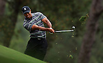 AUGUSTA, GA - APRIL 8:  Tiger Woods hits out of the rough during the 2010 Masters Tournament held in Augusta, Georgia at Augusta National Golf Club on April 8, 2010. (Photo by Donald Miralle)..