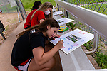 WOLCOTT, CT. 10 June 2020-061020BS17 - Wolcott Girls Softball players and teammates, Sophomores Kaitlyn Ouellette, front, and Kayla Nuehlen, behind, write messages of congratulations and good luck on photo boards as they honor the Wolcott Girls Softball team seniors at the Wakelee Elementary School field on Wednesday. Bill Shettle Republican-American