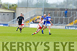 An Ghaeltacht's Cian O'Murchú bursting upfield as Templenoe's Sean Sheehan tackles for possession in the Intermediate Club football championship final on Sunday