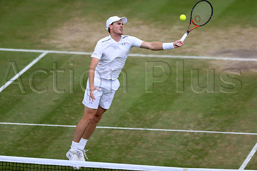 July 11th 2017, All England Lawn Tennis and Croquet Club, London, England; The Wimbledon Tennis Championships, Day 8; Jamie Murray (GBR) leaps to volley a return to Lucie Hradecka during Martina Hingis (CHE) and Jamie Murray (GBR) versus Lucie Hradecka (CZE) and Roman Jebavy (CZE)