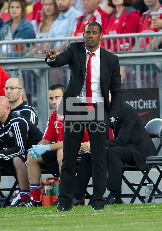 Toronto FC head coach Aron Winter gives instructions to his players during an MLS game between the Seattle Sounders FC and the Toronto FC at BMO Field in Toronto on June 18, 2011..The Seattle Sounders FC won 1-0.