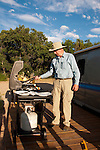 USA, Utah, grilling dinner at classic Airstream travel trailers available as lodging at the Shooting Star Drive-In in Escalante.