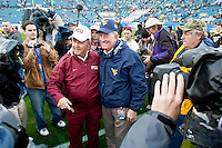 January 01, 2010:    Florida State head coach Bobby Bowden talks with West Virginia head coach Bill Stewart on the field prior to the start of the Konica Minolta Gator Bowl College football action between the West Virginia Mountaineers and the Florida State Seminoles played at the Jacksonville Municipal Stadium in Jacksonville, Florida on January 01, 2010.  Florida State defeated West Virginia 33-21.