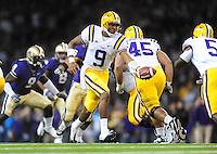 Sept. 5, 2009; Seattle, WA, USA; LSU Tigers quarterback (9) Jordan Jefferson hands the ball off against the Washington Huskies at Husky Stadium. LSU defeated Washington 31-23. Mandatory Credit: Mark J. Rebilas-