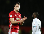 Phil Jones of Manchester United applauds the fans during the Premier League match at the Old Trafford Stadium, Manchester. Picture date: November 27th, 2016. Pic Simon Bellis/Sportimage