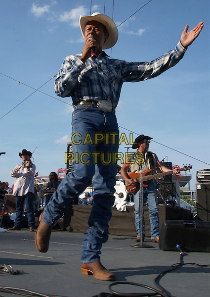 NEAL McCOY.2007 CMA Music Festival held at Greased Lightning Daytime Stage at Riverfront Park, Nashville, Tennessee, USA..June 7th, 2007 .full length stage concert live music gig performance jeans denim singing .CAP/ADM/LF.©Laura Farr/AdMedia/Capital Pictures