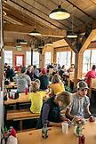 ALASKA, Ketchikan, people gather ad eat inside of the Alaska Fishouse