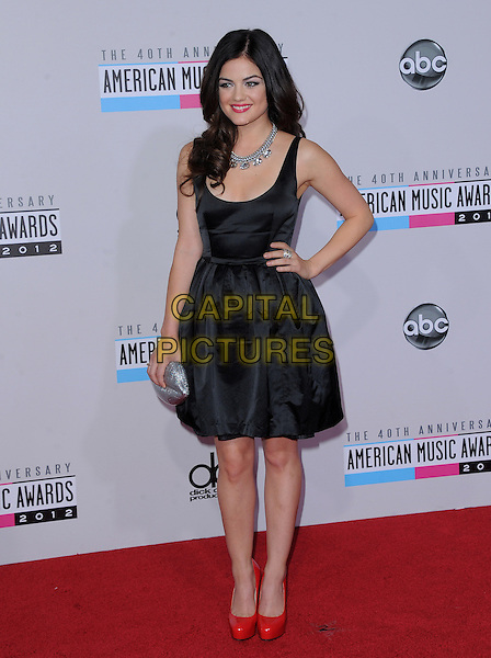 Lucy Hale.40th Anniversary American Music Awards - Arrivals held at Nokia Theatre L.A. Live, Los Angeles, California, USA..November 18th, 2012.AMA AMAs full length dress sleeveless black red shoes silver clutch bag necklace hand on hip.CAP/DVS.©DVS/Capital Pictures.