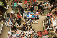 Hordes of shoppers inside Macy's in New York looking for bargains on Black Friday, the day after Thanksgiving, Friday, November 25, 2011. Many retailers opened their doors on Thanksgiving or opened up for Black Friday the night before extending the shopping day into over 24 hours. (© Richard B. Levine)
