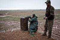 SYRIA: A YPG fighter tests his weapon at a rear base of the village of Shalabiya near the town of Tal Abyad.<br /> <br /> SYRIA: Un combattant YPG teste sont arme à la base arrière du village de Shalabiya près de la ville de Tal Abyad.