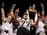 1129101140jlw  4A1foot1205  Saguaro players Wesley Butts, left, Dallas Noriega, middle, (CQ) coach  John Sanders and QB Teddy Ruben celebrate after winning the 4AI State Championship against Canyon del Oro Saturday at Sun Devil Stadium. (Pat Shannahan/ The Arizona Republic)