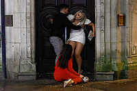 Pictured: A young woman is helped to her feet in Wind Street, Swansea, Wales, UK. Friday 20 December 2019<br /> Re: Black Eye Friday (also known as Black Friday, Mad Friday, Frantic Friday) the last Friday before Christmas, in Swansea, Wales, UK.