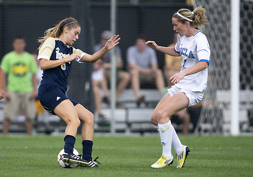 September 01, 2013:  Notre Dame forward Anna Maria Gilbertson (6) and UCLA midfielder Jenna Richmond (7) during NCAA Soccer match between the Notre Dame Fighting Irish and the UCLA Bruins at Alumni Stadium in South Bend, Indiana.  UCLA defeated Notre Dame 1-0.